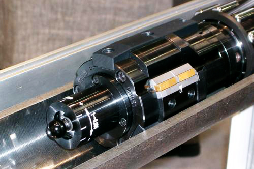 What are the features and benefits of the skiving and roller burnishing tools for the oil cylinder?
